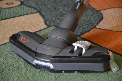 Vacuuming a carpet